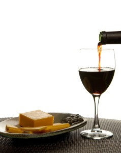 Wine being poured with cheese plate