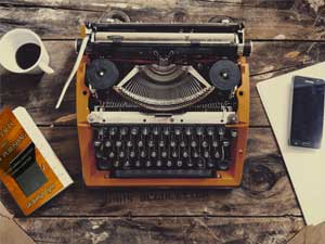 Simple Facts About Self-Publishing by Jacquelyn Lynn next to a typewriter